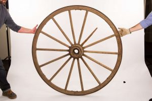 Lesson 2: This wagon wheel was propped at the front entrance of the Broken Spoke dance hall for many years.