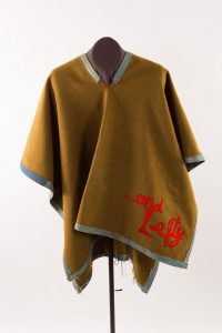 """Lesson 2: Townes Van Zandt owned this poncho with """"…and Lefty"""" appliqued to the front. Van Zandt wrote and recorded the #1 country hit """"Pancho and Lefty."""""""