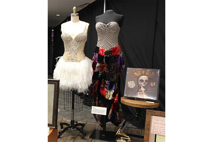 """Dresses designed by Brown's wife, Shelly, and worn by actress Jamie Murray in the carnival-themed video for """"Goodbye in Her Eyes."""" and cover of the vinyl version of the band's 2015 album, Uncaged."""