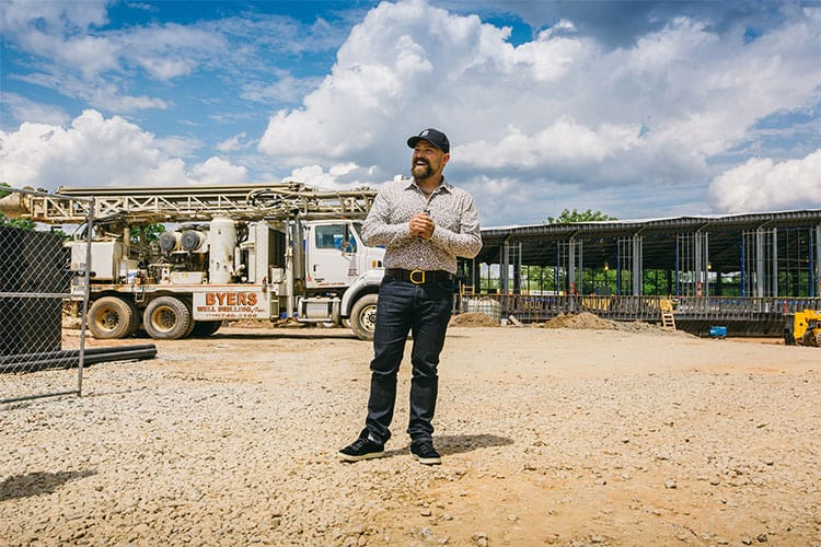 Zac Brown standing in front of the construction site of the Peterson Dining Hall at Camp Southern Ground, 2015.