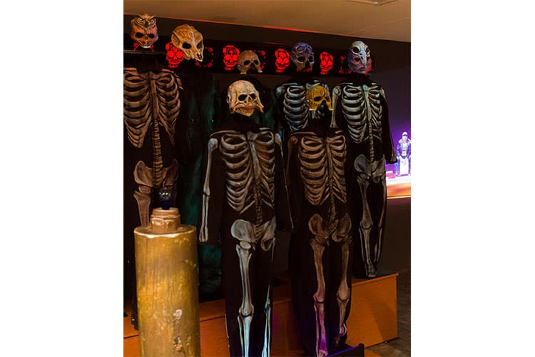 """These black jumpsuits, embellished with spray-painted skeletons, were worn by the Zac Brown Band during performances of """"Day for the Dead."""" Black lights illuminated the skeletons, created by Kristian Baena. Masks made by Baena and Jake Corrick added to the spooky effect."""