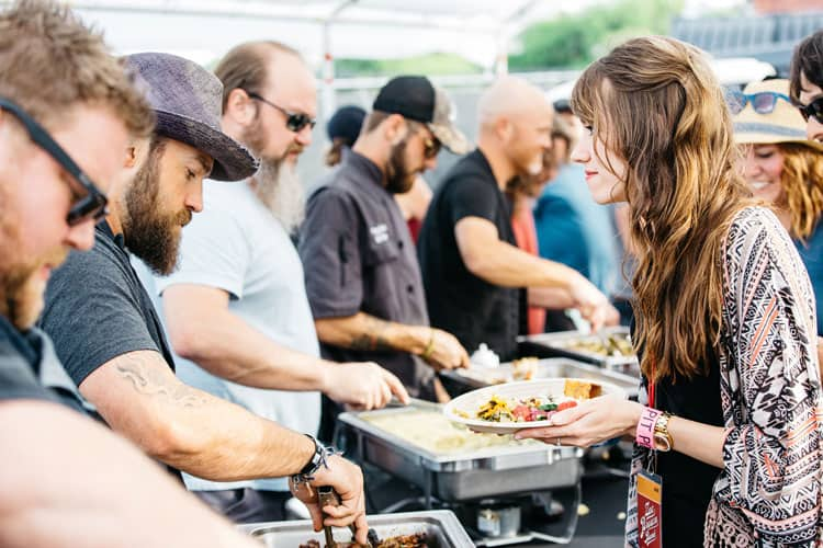 The Zac Brown Band serves guests at an Eat & Greet; July 7, 2015; Bangor, Maine.